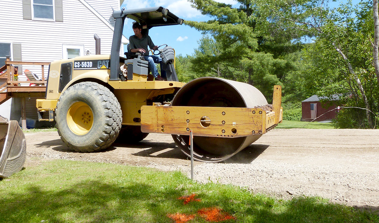 Sam Hall rolling & compacting gravel for a 2 car garage lot in Thomaston, ME